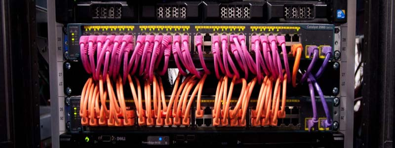 Pink and Orange network cables in a switch